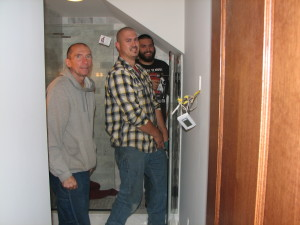 The guys from Marble's Glass installing one of the shower doors.  You guys rock!